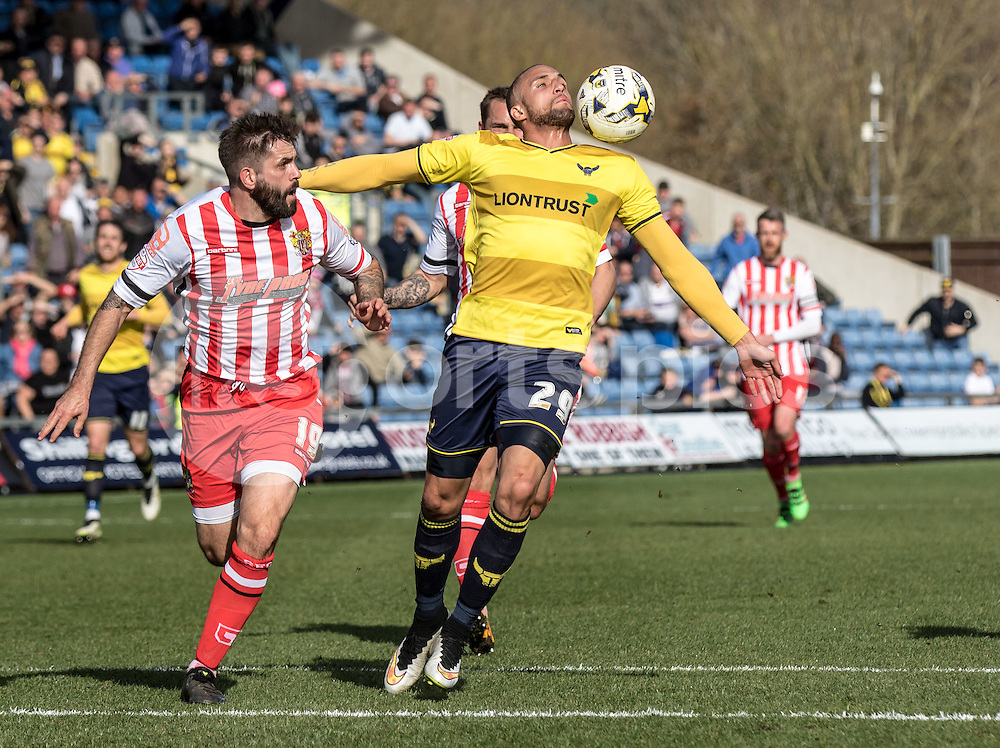 Jordan Bowery of Oxford United wins the ball from Dean Wells of Stevenage during the Sky Bet League 2 match between Oxford United and Stevenage at the Kassam Stadium, Oxford, England on the 25th March 2016. Photo by Liam McAvoy.
