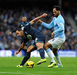 Manchester City's Joleon Lescott challenges Tottenham Hotspur's Mousa Dembele - Photo mandatory by-line: Dougie Allward/JMP - Tel: Mobile: 07966 386802 24/11/2013 - SPORT - Football - Manchester - Etihad Stadium - Manchester City v Tottenham Hotspur - Barclays Premier League