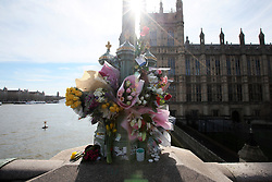 UK ENGLAND LONDON 25MAR17 - Floral tributes are laid outside Parliament for the victims of Wednesday's terror attack. Four people were killed after the assailant, Khalid Masood mowed down pedestrians on Westminster Bridge and crashed into parliament's gates.<br /> <br /> <br /> jre/Photo by Jiri Rezac<br /> <br /> © Jiri Rezac 2017