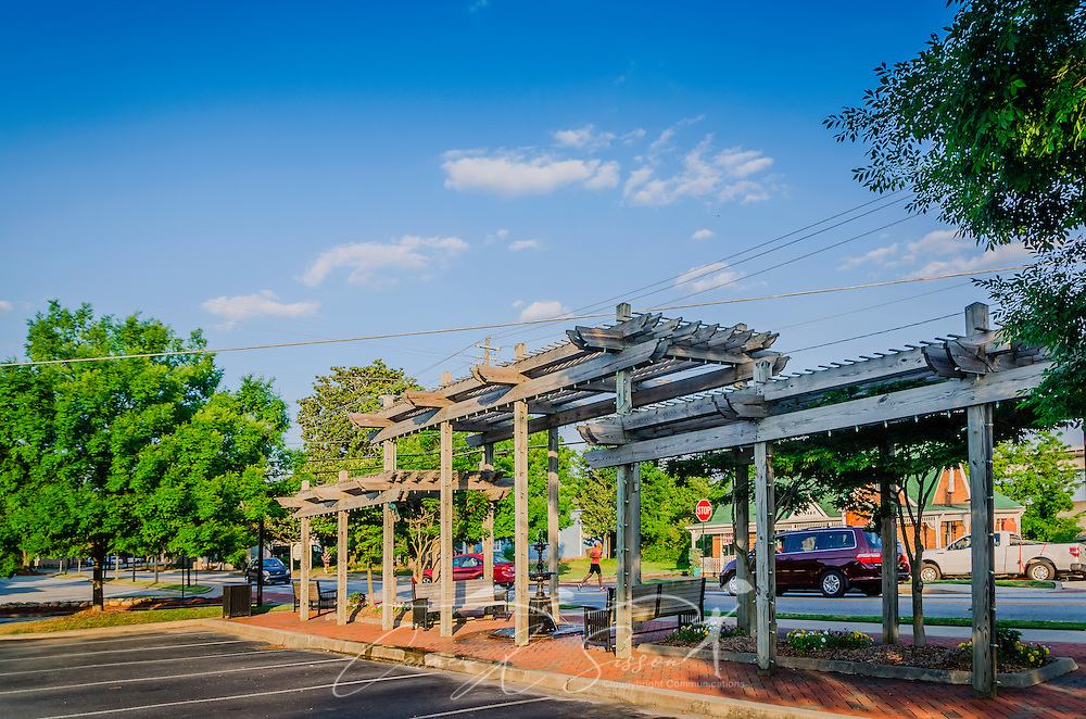 The sun sets on the pergola and fountain in downtown Chamblee, Georgia, May 20, 2014. (Photo by Carmen K. Sisson/Cloudybright)