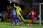 Walsall goalkeeper Liam Roberts (1) punching the ball during the EFL Sky Bet League 1 match between AFC Wimbledon and Walsall at the Cherry Red Records Stadium, Kingston, England on 21 August 2018.