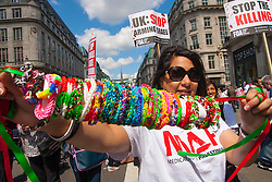 London, August 9th 2014. A woman displays her loom bands as tens of thousands from across the UK march in support of the people of |Palestine.