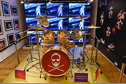 "© Licensed to London News Pictures. 18/10/2018. LONDON, UK. Roger Taylor's drum kit on display in the Queen pop-up shop which has opened in Carnaby Street.  Coinciding with the release next week of the movie ""Bohemian Rhapsody"", the shop offers Queen music fans memorabilia, a display of stage costumes as well as archived Queen performance footage.  Photo credit: Stephen Chung/LNP"