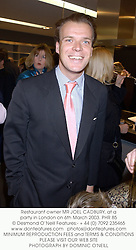 Restaurant owner MR JOEL CADBURY, at a party in London on 6th March 2003.	PHR 85