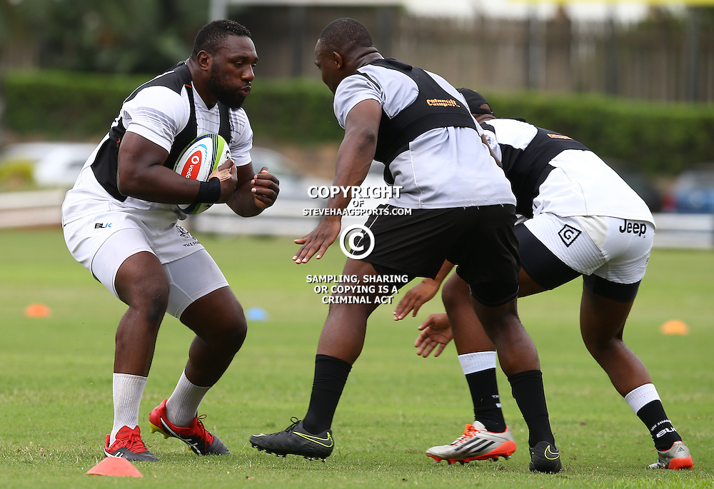 DURBAN, SOUTH AFRICA - JANUARY 13: Chiliboy Ralepelle tackling Tendai Beast Mtawarira during the Cell C Sharks training session at Growthpoint Kings Park on January 13, 2017 in Durban, South Africa. (Photo by Steve Haag/Gallo Images)