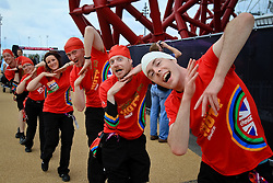 The fans weren't the only people acting strange at Olympic Park -- Coca-Cola volunteers danced around the park.