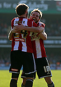 Tommy Smith celebrating setting up goal with Alan Judge during the Sky Bet Championship match between Brentford and Nottingham Forest at Griffin Park, London, England on 6 April 2015. Photo by Matthew Redman.