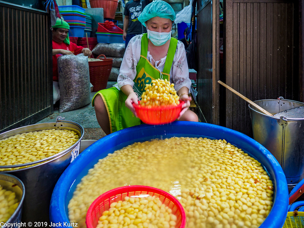 03 FEBRUARY 2019 - BANGKOK, THAILAND: A woman sorts cooked soybeans in a workshop in Bangkok's Chinatown district. The soybeans will be used to make desserts and snacks for Chinese New Year. Chinese New Year celebrations in Bangkok start on February 4, 2019. The coming year will be the Year of the Pig in the Chinese zodiac. About 14% of Thais are of Chinese ancestry and Lunar New Year, also called Chinese New Year or Tet is widely celebrated in Chinese communities in Thailand.         PHOTO BY JACK KURTZ