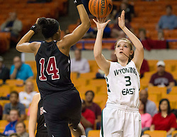 Wyoming East guard Kara Sandy (3) shoots a three pointer that is blocked by Bluefield center Essence Brown (14) during a first round game at the Charleston Civic Center.