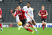 Shrewsbury Town defender Mat Sadler (3) under pressure from Milton Keynes Dons midfielder Chuks Aneke (25) during the EFL Sky Bet League 1 match between Milton Keynes Dons and Shrewsbury Town at stadium:mk, Milton Keynes, England on 25 February 2017. Photo by Dennis Goodwin.