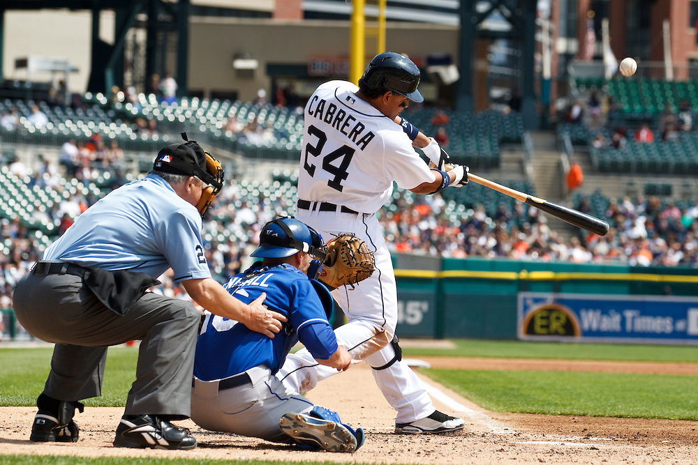 April 14, 2010:  Kansas City Royals' Jason Kendall (18) and Detroit Tigers' Miguel Cabrera (24) during the MLB baseball game between the Kansas City Royals vs Detroit Tigers at  Comerica Park in Detroit, Michigan.
