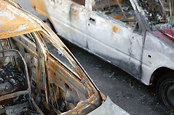 Remains of burnt out cars,
