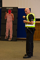 EMBARGOED TILL 16:00 14 DECEMBER 2017Pictured: Inspector Jim Young demontstrated the Taser X2<br /> <br /> Deputy Chief Constable Johnny Gwynne was at Tullialan Police College today to make an announcement on police officer safety with 500 sadditional officers being trained and deployed with tasers to combat the number of incidents where officers are injured.<br /> <br /> Ger Harley | EEm 14 December 2017