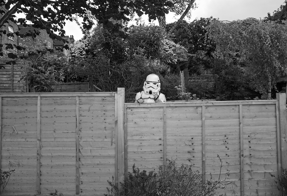 James dressed as a Storm Trooper looks over the fence in the backyard in Berkhamsted, England Friday, May 15, 2015 (Elizabeth Dalziel) #thesecretlifeofmothers #bringinguptheboys #dailylife