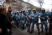 Members of Russia's OMON (Special Force) barricade a crowd of peaceful protesters in Moscow. .Police detained Garry Kasparov, the former world chess champion who now leads one of Russia's strongest opposition movements, and 170 other activists as they gathered for a forbidden anti-Kremlin demonstration in central Moscow..The demonstration, one in a series of so-called Dissenters' Marches, increased tension between opposition supporters who complain the Kremlin is cracking down on political dissent and authorities who vow to block any unauthorized demonstrations.