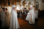 Bishop Edward J. Burns, left is welcomed by Bishop Greg Kelly on Wednesday, Feb. 8, 2017 at Cathedral Guadalupe as he prepares to become the eighth bishop of the Catholic Diocese of Dallas. (Photo by Kevin Bartram)