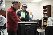 Dr. Peter Weyland goes over the test results with Ryan Hall after a series of tests on the treadmill at the SMU Locomotor Performance Lab in Dallas, Texas on March 18, 2016. (Cooper Neill for The New York Times)
