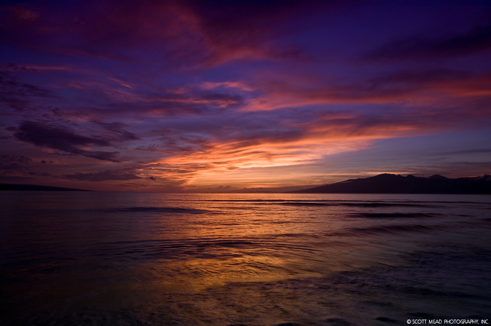 Bright colors of sunset with view of Molokai, Maui Country, Hawaii