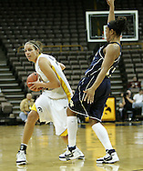 28 NOVEMBER 2007: Iowa forward Wendy Ausdemore (32) looks for an open player to pass the ball to while being guarded by Georgia Tech guard Chioma Nnamaka (43) in the first half of Georgia Tech's 76-57 win over Iowa in the Big Ten/ACC Challenge at Carver-Hawkeye Arena in Iowa City, Iowa on November 28, 2007.