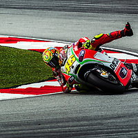 Italian MotoGP rider Valentino Rossi of Ducati Team tries to balance himself before fall from his motorcycle during a practice session during Malaysian Motorcycle Grand Prix at Sepang International Circuit near Kuala Lumpur, Malaysia 20 October 2012.
