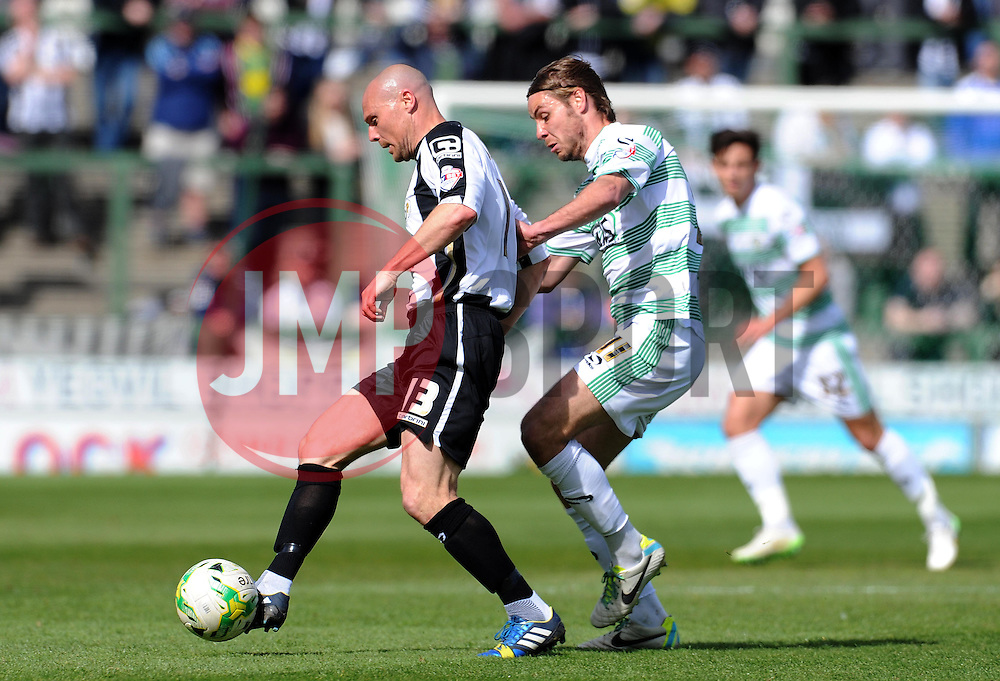 Gary Jones of Notts County is tackled by Yeovil Town's Sam Foley- Photo mandatory by-line: Harry Trump/JMP - Mobile: 07966 386802 - 11/04/15 - SPORT - FOOTBALL - Sky Bet League One - Yeovil Town v Notts County - Huish Park, Yeovil, England.
