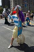 A participant in a half male, half female costume.