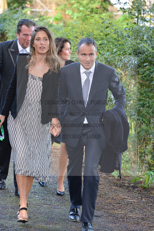 BEN GOLDSMITH and JEMIMA JONES at the wedding of Princess Florence von Preussen second daughter of Prince Nicholas von Preussen to the Hon.James Tollemache youngest son of the 5th Lord Tollemache held at the Church of St.Michael & All Angels, East Coker, Somerset on 10th May 2014.