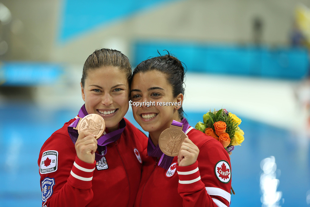 31.07.2012. London, England. Rose Line Filion Meaghan Benfeito of Canada Pose AT The Awarding Ceremony of womens Synchronised 10m platform Event AT The London 2012 Olympic Games in London  The Canadian Divers Won Bronze Medal in This Event
