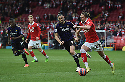 Bristol City's Luke Ayling controls the ball as West Ham's Andy Carroll closes in - Photo mandatory by-line: Paul Knight/JMP - Mobile: 07966 386802 - 25/01/2015 - SPORT - Football - Bristol - Ashton Gate - Bristol City v West Ham United - FA Cup fourth round