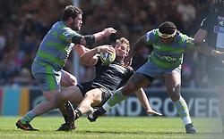Exeter Chiefs' Sam Hill is tackled by Newcastle Falcons' Sam Lockwood and Scott Wilson during the Aviva Premiership Semi Final at Sandy Park, Exeter.
