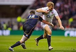 England Inside Centre (#12) Billy Twelvetrees (Gloucester) is tackled by Scotland Inside Centre (#12) Matt Scott (Edinburgh) during the first half of the match - Photo mandatory by-line: Rogan Thomson/JMP - Tel: Mobile: 07966 386802 02/02/2013 - SPORT - RUGBY UNION - Twickenham Stadium - London. England v Scotland - 2013 RBS Six Nations Championship. The winner of this fixture is awarded the Calcutta Cup.