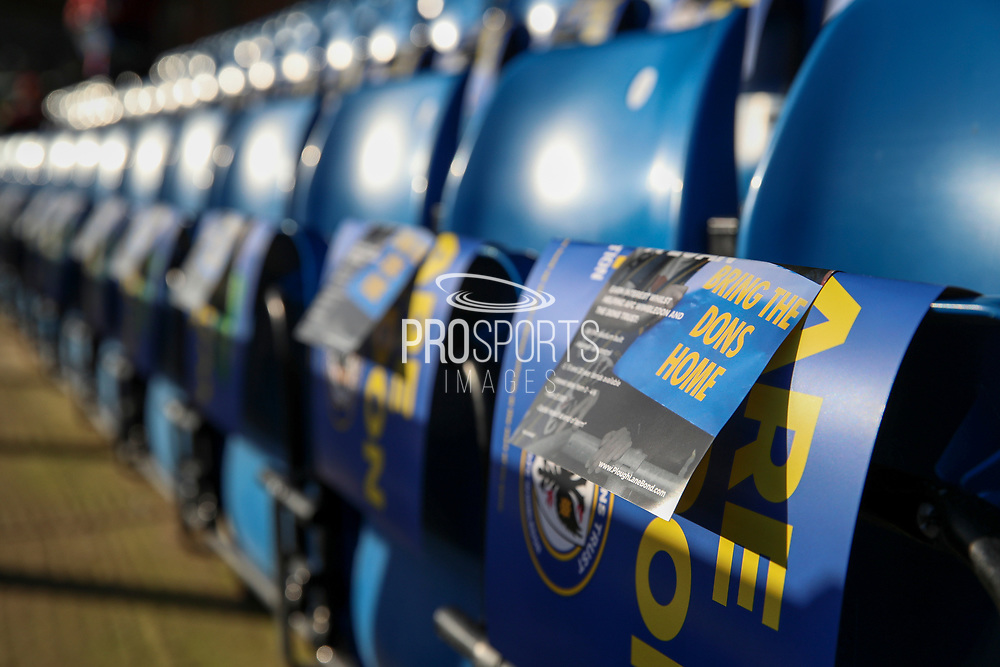 AFC Wimbledon leaflet saying bring the dons home which is in reference to the new stadium during the EFL Sky Bet League 1 match between AFC Wimbledon and Peterborough United at the Cherry Red Records Stadium, Kingston, England on 18 January 2020.