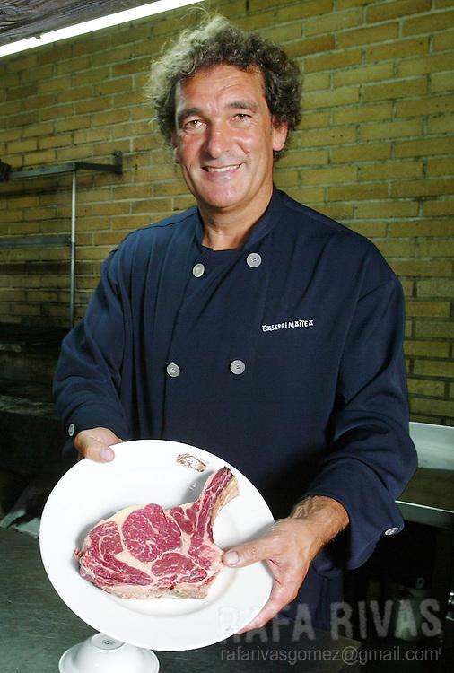 Baserri Maitea Basque Restaurant's chef, Juan Antonio Zaldua, cooks some meat at his restaurant's kitchen in Forua, Basque Country. July 21, 2006