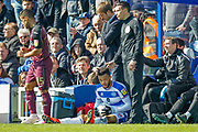 Queens Park Rangers midfielder Jordan Cousins (8) on the floor having been foulded next to the technical area, during the EFL Sky Bet Championship match between Queens Park Rangers and Swansea City at the Loftus Road Stadium, London, England on 13 April 2019.
