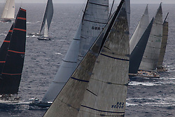 Swan 80, Selene, races along the southern coast of St. Maarten during the RORC Caribbean 600