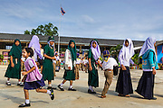 11 JULY 2013 - PATTANI, PATTANI, THAILAND:   Students walk to class after morning assembly at the Bantaladnadklongkud School in Pattani. There are 108 students at Bantaladnadklongkud School and they are all Muslims. Five of the school's eight teachers are Buddhists.    PHOTO BY JACK KURTZ