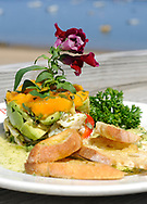 PROVINCETOWN -- 070312 -- The Lobster Pot's lobster avocado cocktail with papaya, sweet pepper vinaigrette and tarragon mayo.  Cape Cod Times/Christine Hochkeppel