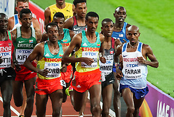 London, August 12 2017 . Muktar Edris, Ethiopia, Yomif Kejelcha, Ethiopia, and Mo Farah, Great Britain, fight for the lead of the men's 5000m final on day nine of the IAAF London 2017 world Championships at the London Stadium. © Paul Davey.