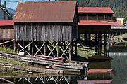 """A historic stilt home along Hammer Slough fishing village in Petersburg Island, Alaska. Petersburg was settled by Norwegian immigrants in the late 1800 and is often called """"Little Norway""""."""