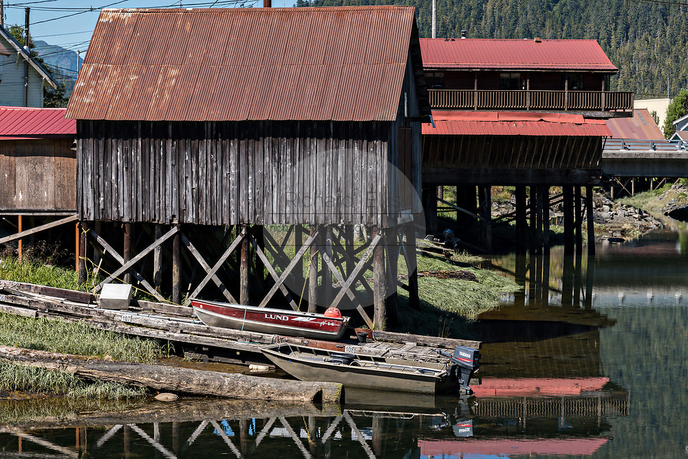 "A historic stilt home along Hammer Slough fishing village in Petersburg Island, Alaska. Petersburg was settled by Norwegian immigrants in the late 1800 and is often called ""Little Norway""."
