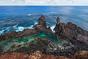 St. Paul's Pool, a natural pool found along the coast of the volcanic landscape of Pitcairn island.