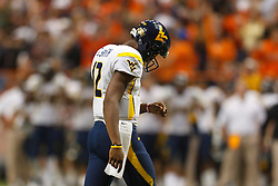 Oct 21, 2011; Syracuse NY, USA;  West Virginia Mountaineers quarterback Geno Smith (12) reacts after throwing an interception against the Syracuse Orange during the fourth quarter at the Carrier Dome.  Syracuse defeated West Virginia 49-23. Mandatory Credit: Jason O. Watson-US PRESSWIRE