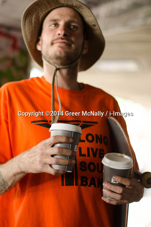 One of the organisers of the Long Live Southbank celebration on the May bank holiday having a well-earned coffee after throwing decks into the crowd