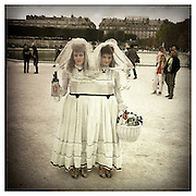 10-4-11 --- Two models walk around Jardins des Tuileries in Paris to promote a brand of champagne.