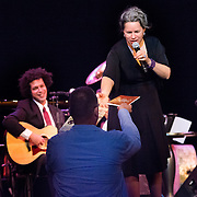 Natalie Merchant exchanges a signed book for a program with a fan during her performance in the 2014 Portsmouth Singer Songwriter Festival at The Music Hall in Portsmouth, NH, on April 12, 2014