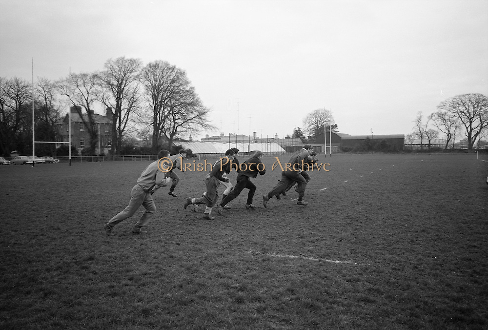 Irish Rugby Football Union, Ireland v England, Five Nations, Ireland practice at Old Belvedere, Dublin, Ireland, Friday 10th February, 1967,.10.2.1967, 2.10.1967,  ..Referee- D M Hughes, Welsh Rugby Union, ..Score- Ireland 3 - 8 England, ..Irish Team, ..T J Kiernan,  Wearing number 15 Irish jersey, Full Back, Cork Constitution Rugby Football Club, Cork, Ireland,..D Scott, Wearing number 14 Irish jersey, Right Wing, Queens University Rugby Football Club, Belfast, Northern Ireland, ..F P K Bresnihan, Wearing number 13 Irish jersey, Right Centre, University College Dublin Rugby Football Club, Dublin, Ireland, ..J C Walsh,  Wearing number 12 Irish jersey, Left Centre, Sundays Well Rugby Football Club, Cork, Ireland, ..N H Brophy, Wearing number 11 Irish jersey, Left wing, Blackrock College Rugby Football Club, Dublin, Ireland, ..C M H Gibson, Wearing number 10 Irish jersey, Stand Off, N.I.F.C, Rugby Football Club, Belfast, Northern Ireland, ..B F Sherry, Wearing number 9 Irish jersey, Scrum Half, Terenure Rugby Football Club, Dublin, Ireland, ..K G Goodall, Wearing number 8 Irish jersey, Forward, Newcastle University Rugby Football Club, Newcastle, England, ..M G Doyle, Wearing number 7 Irish jersey, Forward, Edinburgh Wanderers Rugby Football Club, Edinburgh, Scotland, ..N Murphy, Wearing number 6 Irish jersey, Captain of the Irish team, Forward, Cork Constitution Rugby Football Club, Cork, Ireland,..M G Molloy, Wearing number 5 Irish jersey, Forward, University College Galway Rugby Football Club, Galway, Ireland,  ..W J McBride, Wearing number 4 Irish jersey, Forward, Ballymena Rugby Football Club, Antrim, Northern Ireland,..P O'Callaghan, Wearing number 3 Irish jersey, Forward, Dolphin Rugby Football Club, Cork, Ireland, ..K W Kennedy, Wearing number 2 Irish jersey, Forward, C I Y M S Rugby Football Club, Belfast, Northern Ireland, ..T A Moroney, Wearing number 1 Irish jersey, Forward, University College Dublin Rugby Football Club, Dublin, Ireland,