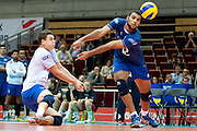(R) Earvin Ngapeth and (L) Jenia Grebennikov both from France receive the ball during the 2013 CEV VELUX Volleyball European Championship match between France and Slovakia at Ergo Arena in Gdansk on September 20, 2013.<br /> <br /> Poland, Gdansk, September 20, 2013<br /> <br /> Picture also available in RAW (NEF) or TIFF format on special request.<br /> <br /> For editorial use only. Any commercial or promotional use requires permission.<br /> <br /> Mandatory credit:<br /> Photo by &copy; Adam Nurkiewicz / Mediasport