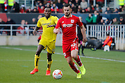 Burton Albion midfielder Lloyd Dyer (11) battles for possession Bristol City defender Bailey Wright (42) during the EFL Sky Bet Championship match between Bristol City and Burton Albion at Ashton Gate, Bristol, England on 4 March 2017. Photo by Richard Holmes.