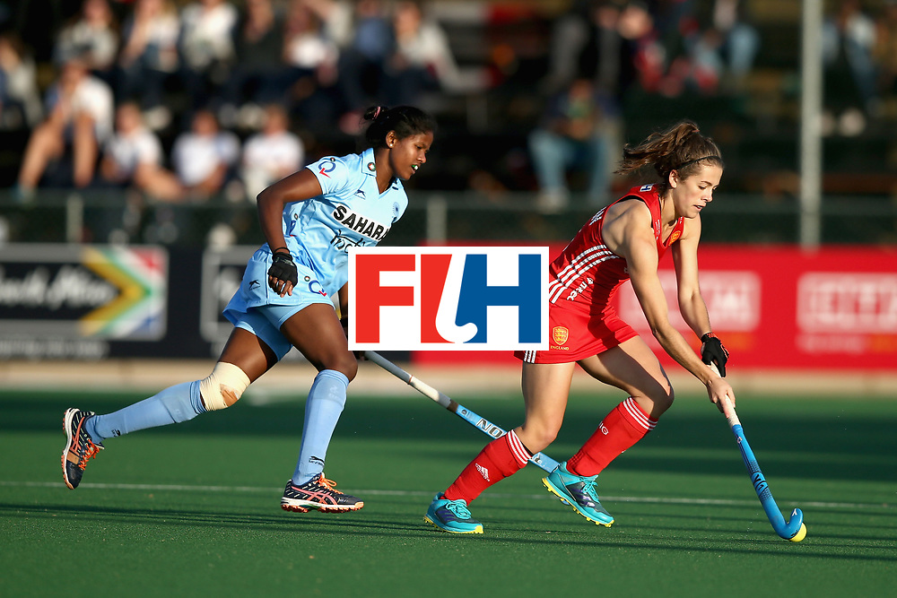 JOHANNESBURG, SOUTH AFRICA - JULY 18: Anna Toman of England takes the ball away from Namita Toppo of India during the Quarter Final match between England and India during the FIH Hockey World League - Women's Semi Finals on July 18, 2017 in Johannesburg, South Africa.  (Photo by Jan Kruger/Getty Images for FIH)