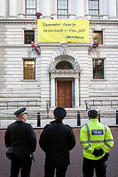 © under license to London News Pictures.  19/10/2010  Greenpeace demonstrators hang from the treasury building in Central London as they protest for a green investment bank.